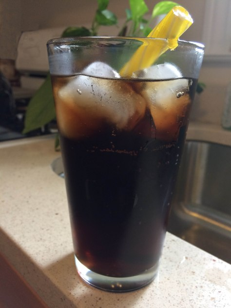 Glass of Coca Cola with Giambri's Lemon Stick for a straw